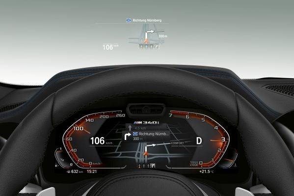 The full-colour BMW Head-Up Display projects all information relevant to the journey directly into the driver's field of vision, thereby allowing them to fully concentrate on driving.